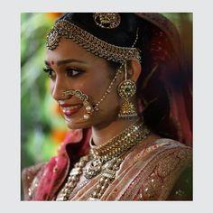 Sruthi a bride from Band Baja Bride looks mesmerizing in Yakhoot (Rubies), Zamarud (Emeralds) & Polkis embedded jewellery from Kishandas & Co. #kishandasjewellery #kishandasandco #since1870 #jewellerymaking #heritagehyderabad #jewellerylover #kishandasbrides #polki