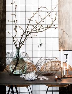 branches & copper vases. Mixing textures is a big trend. Combing metals and woods.