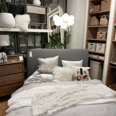 The Haven Platform Bed from West Elm (@westelmaus) has thick padding and is upholstered all over with metal legs. The bed is very cozy and is styled in soft white/silver pillows and lines with one accent pillow giving some personality⁠