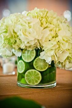 Hydrangea-Centerpiece - I like the limes inside, I am digging the fruit, kind of like the granny smith apples in some of the other center pieces... Are granny smith fall apples???