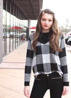 Large gingham print sweater, flattering black trousers, and black leather booties. Perfect autumn style