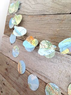 Lets make travel plans... or we could just decorate with this 3D paper garland :)  https://www.etsy.com/au/listing/198041444/paper-circle-garland-up-cycled-travel?ref=shop_home_active_9