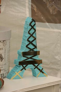 Savannah's 6th Paris Tea Party | CatchMyParty.com...Eiffel Tower mini pinata by @lisafrankparties on Instagram.