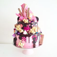 Small 2 Tier Hero Cake with Pink Chocolate Crown Note the metallic gold highlights...enhances the folds in the chocolate
