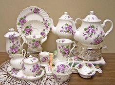 I'd add some more tea cups and saucers...I'd like to have 6-8, since the tea pot is 6 c.