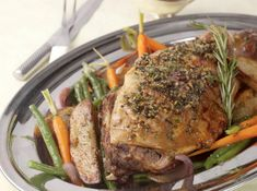 Herb crusted roast leg of lamb with sauteed potato wedges, green beans and carrots. Holland America cruise recipes.