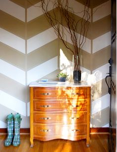 dreamy herringbone walls  vertical stripe is original color, covered in blue tape; white thick stripes get painted; clear gloss makes the darker thick stripe.