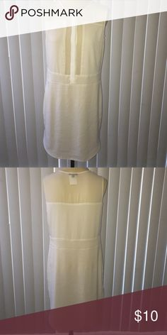 White partially sheer dress White dress with the top half partially sheer! Amazing looking dress that can be worn in the summer or winter! It has never been worn outside of the dressing room, the tags fell off when it was being tried on. XOXO Dresses Midi
