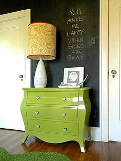 """""""We all know there are thousands of different whites, but most people don't realize that black comes in different shades as well,"""" says designer Erin Benedict of Benedict August Interiors and Design. """"The black used in this project is actually chalkboard paint, which has its own magical quality."""""""
