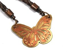 Hand-pierced, cold-connected brass & copper butterfly.