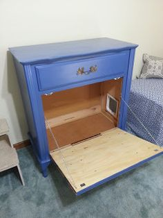 Cat Litter Box enclosure in old dresser with cat door on side