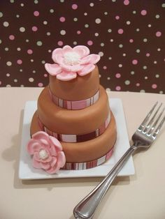 Mini Cake, covered in fondant and topped with a flower.