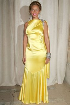 Lemon yellow satin gown in 2004.  Beyonce is beautiful at CFDA Awards.