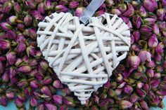Glue some rose buds onto a heart for a Valentines Day or wedding decoration http://driedflowercraft.co.uk