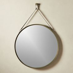 On sale. Pendant mirror perfectly marries rustic and urban with mixed materials and unique shape. Suspended from a natural leather strap, polished looking glass is set deep within trapezoid gunmetal frame. Round Hanging Mirror, Home Decor Mirrors, Wall Mirrors, Pick Up Trash, Natural Leather, Leather Handle, Crate And Barrel, Accent Decor, Metal