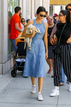 Kendall Jenner wearing a Stella McCartney Denim Wrap Apron Dress, Le Specs X Adam Selman The Last Lolita Sunglasses and Adidas by Raf Simons Stan Smith Sneakers