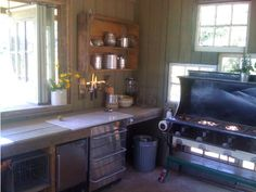 interior campfire kitchen with enameled gas stove found in San Francico