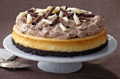 This is a cheesecake for cheesecake lovers!  A white chocolate cheesecake with a chocolate cookie crust is finished off with a creamy chocolate topping and shaved chocolate - oh my!
