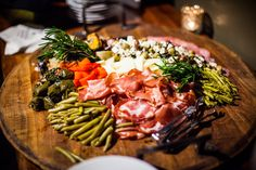 Ravishing Radish Catering's rustic charcuterie platter with an assortment of salami & hot coppa, artisan sliced cheeses, marinated vegetables & croccantini crackers. Ravishing Radish Catering | Char Beck Photography