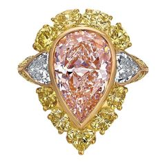 This stunning and rare ring is made in rose and yellow gold. The center pear-shape diamond is a GIA-certified Fancy Light Brownish Pink, diamond. There are also fancy yellow diamonds totaling approximately carats, and two white diamonds totaling carats. Pink Diamond Ring, Pear Shaped Diamond, Diamond Jewelry, Gold Ring, Oval Diamond, Vintage Engagement Rings, Diamond Engagement Rings, Solitaire Engagement, Mellow Yellow