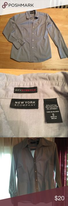 Gray women's dress shirt. Women's gray button up dress shirt. Worn multiple times. Good condition. New York & Company Tops Button Down Shirts
