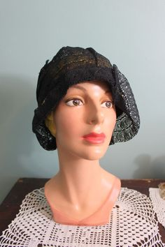 http://www.ebay.com/itm/Vintage-1920s-black-ART-DECO-lace-asymmetrical-cloche-22-/161342273749?pt=LH_DefaultDomain_0