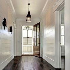 Shiplap lining the halls to a stunning porch lantern! French Quarter on … Shiplap lining the halls to a stunning porch lantern! French Quarter on a ladder rack. Style At Home, French Quarter, Home Design, Interior Design, Porch Lanterns, Decoration Entree, Sweet Home, White Shiplap, White Wood