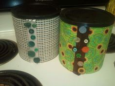 Homemade laundry soap in Coffee cans covered in fabric.