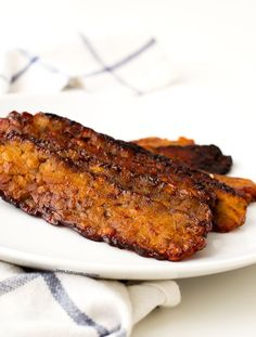 This tempeh bacon is not the healthiest food in the world, but is much healthier than regular bacon and also has less fat and is cholesterol-free.