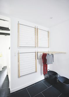 four wall mounted drying racks (from Ikea!) to create an instant indoor drying room - super great space saving idea {remodelista} Laundry Room Design, Laundry In Bathroom, Basement Laundry, Ikea Laundry Room, Laundry Closet, Laundry Room Ideas Garage, Ikea Mudroom Ideas, Ikea Mud Room, Small Laundry Space
