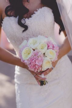 Garden roses and pink hydrangea wrapped in silk ribbon. Photo: Adam Trujillo Photography