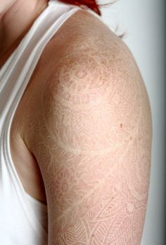 lace tattoo, white ink