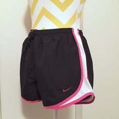NIKE Fit Dry Running Shorts Size Small NIKE Fit Dry running shorts in black with pink and white trimming. They are size Small and have the underwear lining built in. They have been worn once. In excellent condition. No stains, tares or odors. Comes from a smoke free and pet free home. No trades. Nike Shorts
