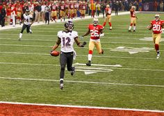 Baltimore Ravens wide receiver Jacoby Jones (12) runs back the opening kick-off of the second half for a 109-yard touchdown against the San ...