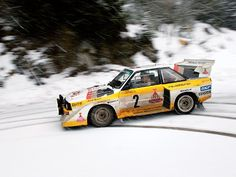 Audi Quattro Sport S2....I find this car's angular design interesting/ functional, and the shot reminds me of the occasional winter drift driving to work. :-)