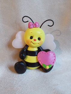 bee bumble bee bug sculpture Christmas ornament cake topper sculpture figurine gift polymer clay. $16.95, via Etsy.