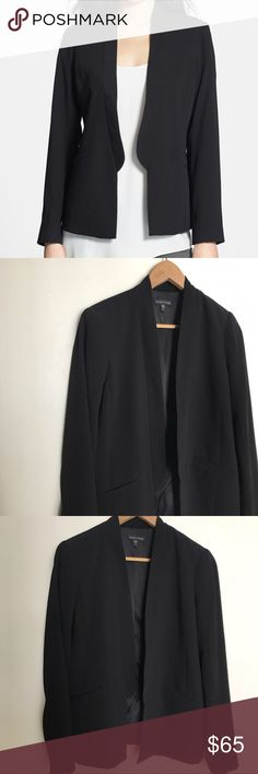 """Eileen Fisher black stand collar tuxedo jacket 6 Gorgeous tuxedo-style blazer by Eileen Fisher. Size 6. Polyester/silk. Slit pocket detail. Standing collar. No closure. Pre-owned in like-new condition. No visible flaws or wear.  Measurements (approximate, laid flat): Bust: 18.5"""" Length: 26"""" Sleeve: 24"""" Shoulder-to-shoulder: 17"""" Eileen Fisher Jackets & Coats Blazers"""