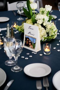 Navy blue linen, textured white and green centerpieces