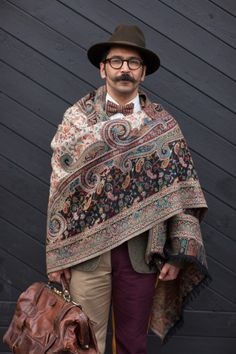 Eccentric vintage luxury, carefully curated and styled. WGSN street style at Pitti Uomo Subscribersclick herefor trends and full images galleries!