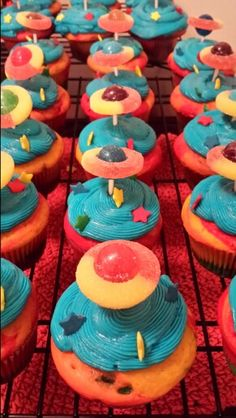Space cupcakes with rainbow center.