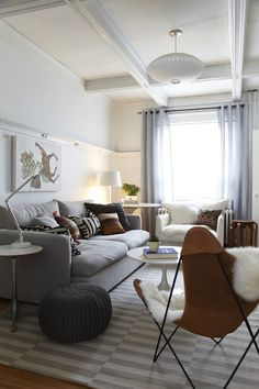 Love the boarder in the middle of the wall; perhaps a little higher?? IKEA Stockholm Rand rug in grey, white walls, grey couch, cushions