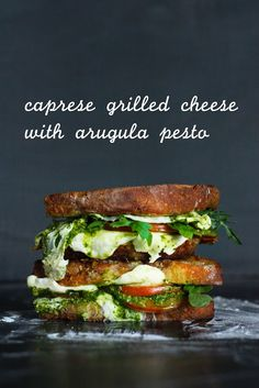 Caprese Grilled Cheese with Arugula Pesto — mozzarella, tomatoes, garlic, almonds, fresh basil, arugula, olive oil, lemon juice,  sourdough bread and butter.