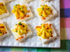 Square Deviled Eggs [Bake whites in a square pan, cut into squares. Scramble eggs, then run through the blender with seasonings. Assemble as shown.] From Food Network Kitchen via Food Network