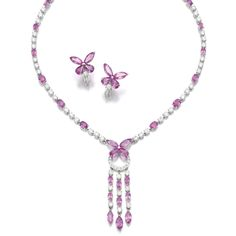 Pink sapphire and diamond demi-parure, Graff Comprising: a necklace designed as line of oval pink sapphires and brilliant-cut diamonds suspending a tassel, similarly set, surmounted by a butterfly motif set with pear- and lozenge-shaped pink sapphires, length approximately 415mm, and a pair of ear clips, each signed Graff, case stamped Graff, illustrated opposite.