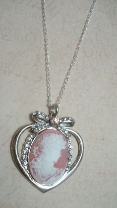 Pink Queen Cameo Pendant Necklace. $20.99, via Etsy. #cameo #queen #pinkjewelry #pinknecklace