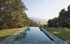 Infinity pool with stone surroundings. Splendid Sass: BOBBY MCALPINE ~ DESIGN IN WINE COUNTRY