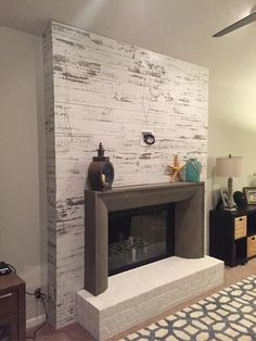 Like the idea of wood accent wall around the fireplace.Timeline Wood in. Distressed White Wood Panels 00955 at The Home Depot - Mobile Fireplace Tv Wall, Brick Fireplace Makeover, Shiplap Fireplace, Fireplace Remodel, Fireplace Surrounds, Fireplace Design, Fireplace Mantels, Fireplace Refacing, Wallpaper Fireplace
