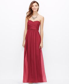 """<p>Shirred detail sculpts the bodice of this luxe silk style for a sophisticated look. Strapless. Inside bustier. Empire waist. Hidden side zipper. Lined. 45"""" from natural waist. </p>  <p>  <br />  <br />  <em><span style=""""color: purple;"""">Items in our Weddings """" Events Collection can only be exchanged or returned by mail. <br /></span></em></p>"""
