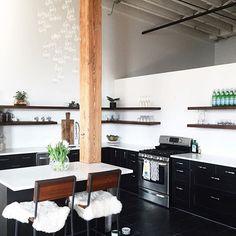 Dream kitchen complete. Just add people.   (open shelves, black and white kitchen, loft, detroit loft. floating shelves, industrial kitchen)