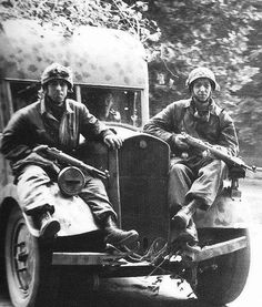 German Paratroopers on the truck during the retreat from Normandy, August 1944